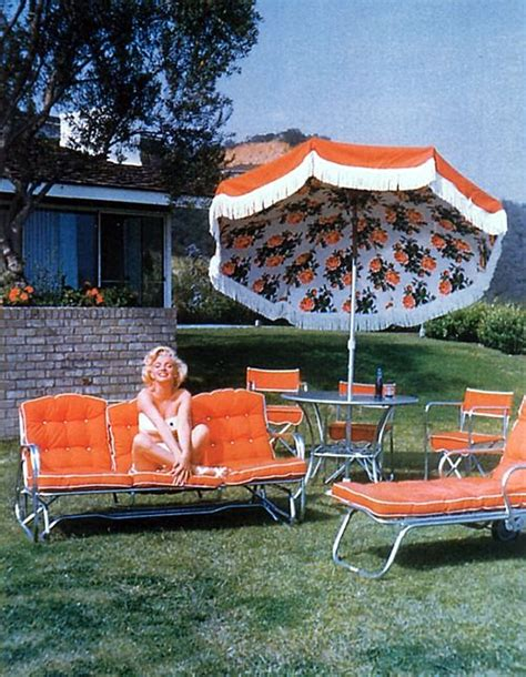 marilyn on bright orange patio furniture rooms