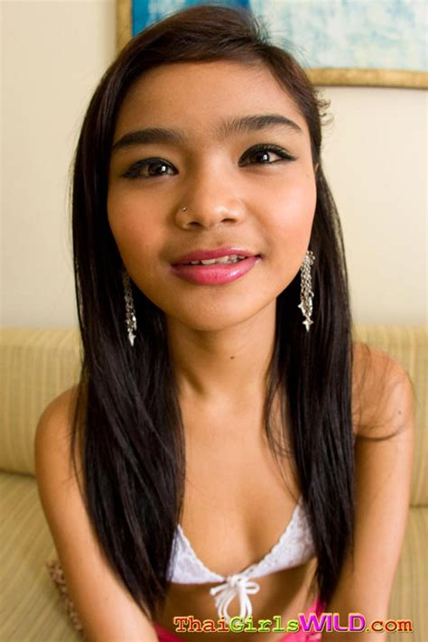 little petite thai teen panni strips down to show off her
