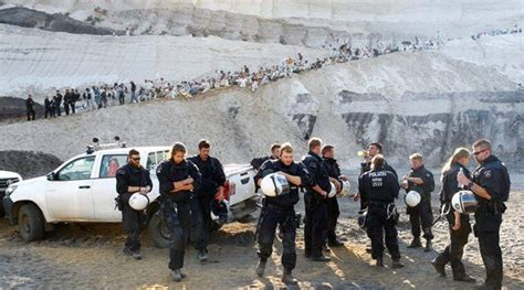 Climate protesters storm open-pit mine in western Germany ...