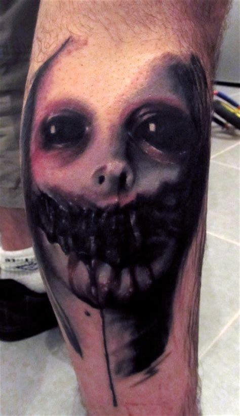 black  grey horror face tattoo  hand