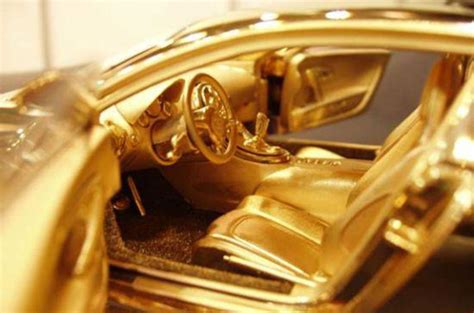 Take a look at the front & rear view, side & top view & all the pictures of chiron. £2m solid gold Bugatti Veyron   Autocar