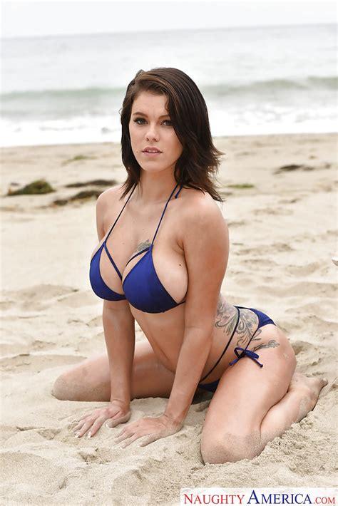 Brunette Solo Girl Peta Jensen Letting Fake Tits Free From Bikini On Beach