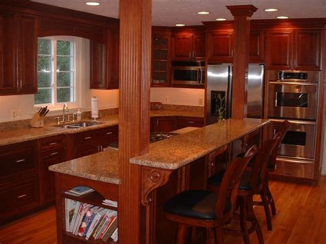 kitchen island and bar island with cook top and breakfast bar we then installed