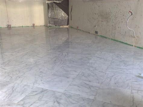 carrara marble tile floor process of facing of a floor by marble tile bianco carrara
