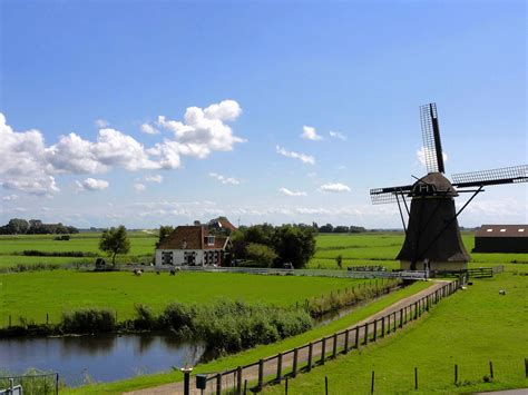 Scenic spring countryside landscape with windmill ...