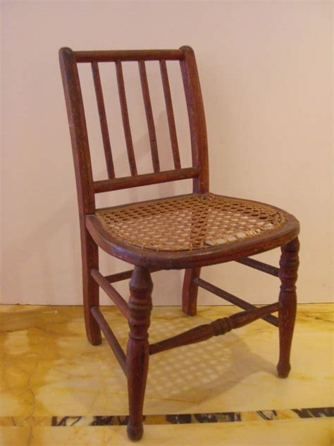 miniature painted dolls chair with wicker seat for
