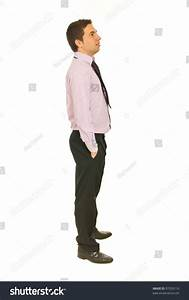 Full Length Of Business Man Standing In Profile With Hands ...