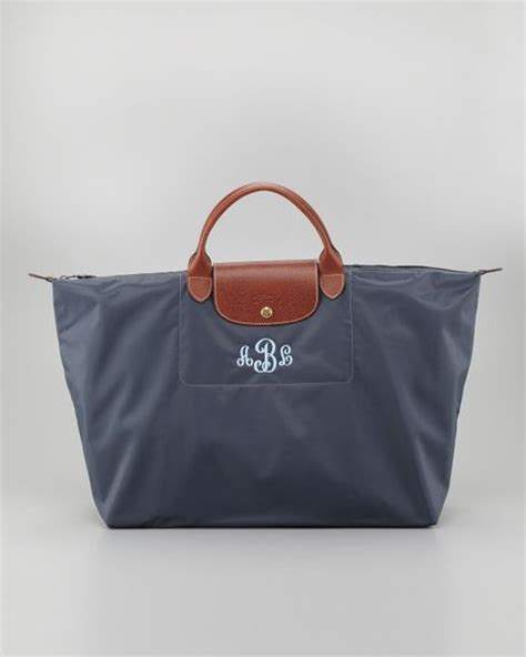 longchamp le pliage monogrammed travel bag  blue