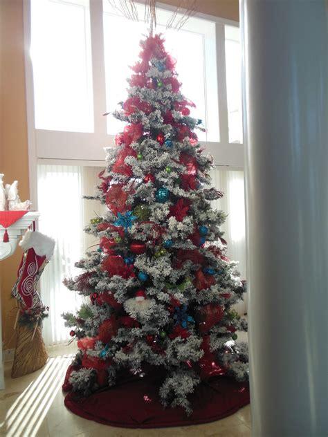 glamorous flocked christmas tree  spaces traditional