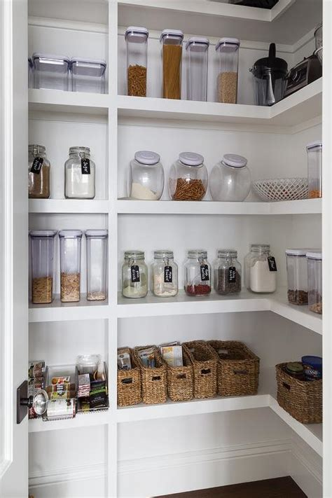 white stacked pantry shelves  labeled mason jars