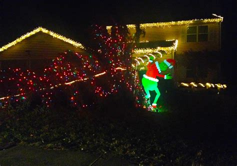 grinch stealing lights christmas decorations