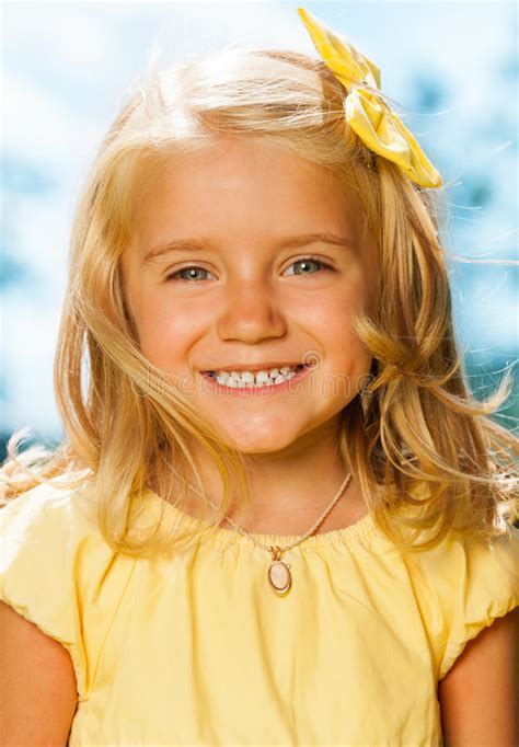 Close Portrait Of Smiling Blond Little Girl Stock Photo