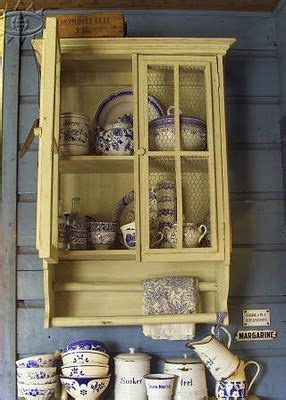 chicken wire kitchen cabinets charming yellow cupboard has a chicken wire front 5387