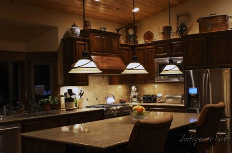 Decorating Ideas For Kitchen With Cherry Cabinets by Antique Or Not Decorating Above Your Cabinets