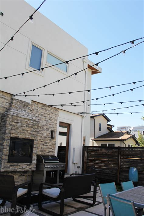 how to hang outdoor string lights remodelaholic 36 clever string light ideas
