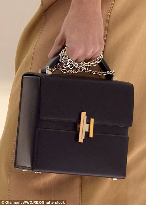 hermes unveils luxury coats  covetable bags  paris