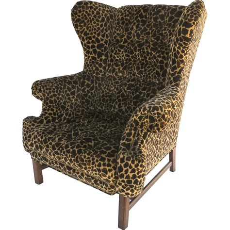 large scale vintage wing chair with legs and