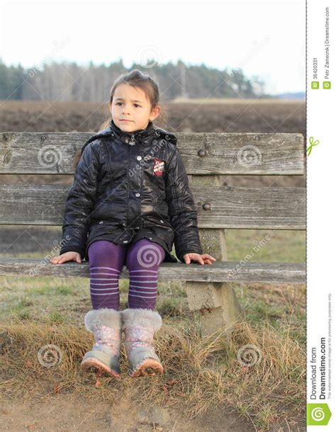Little Kid  Girl Sitting On A Bench Stock Image Image
