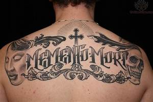Skull Cross Upper Back Lettering Tattoo - TattooMagz