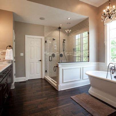 free standing tub wood tile floor shower