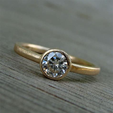 moissanite and recycled 14k yellow gold engagement ring