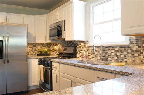 white cabinets  salt  pepper granite