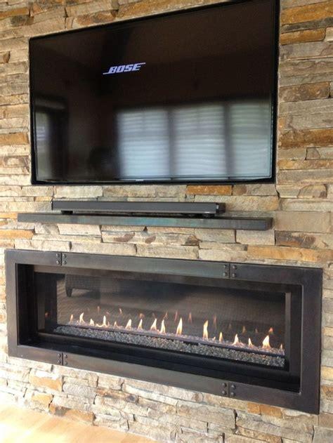 tv   ribbon fireplace  custom iron surround