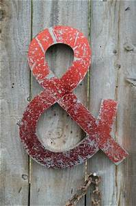 funky large red metal 3 dimensional ampersand shop sign With red metal letters decorative