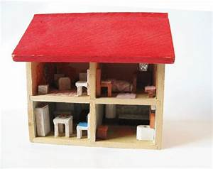 very small sturdy wooden doll house perhaps N scale