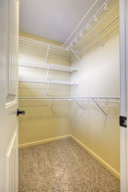 master closet with wire shelving living together