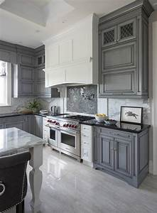 white kitchen hood with dark gray mosaic cooktop With kitchen cabinet trends 2018 combined with arctic monkeys wall art