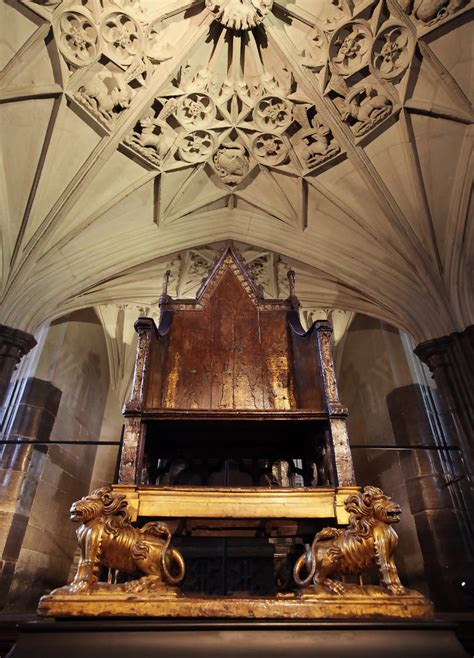 King Edward Coronation Chair by Visitors Look At The Coronation Chair In Westminster
