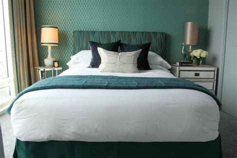 bedroom shimmers  patterned teal accent wall hgtv