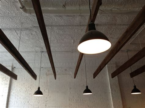 bowl pendants add industrial feel to classic