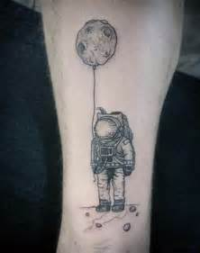 Astronaut Holding Planet Tattoo