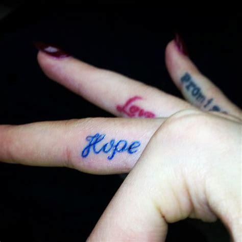 rita ora writing finger tattoo steal  style