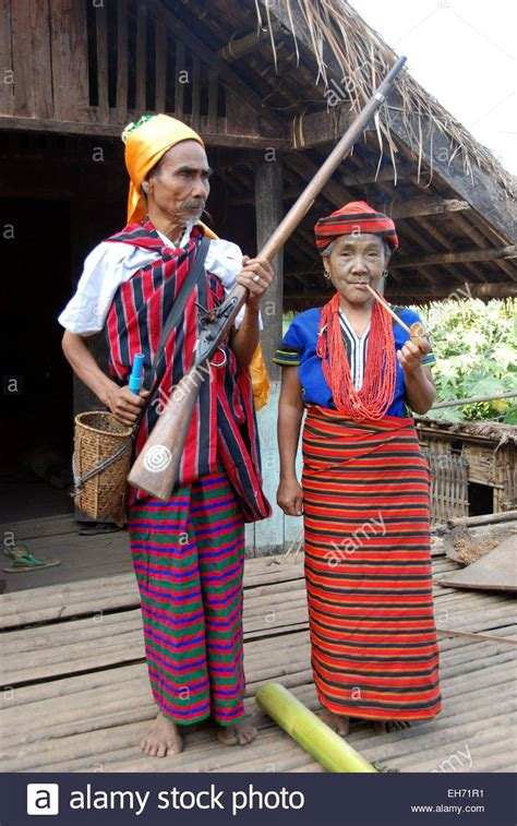 tribal couple wearing traditional costumes  front   house stock photo alamy