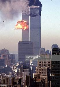 A hijacked commercial plane crashes into the World Trade ...