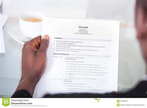 person reading resume stock photo image 46358076