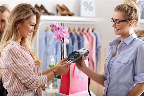 Women buying clothes in clothes store — Stock Photo ...