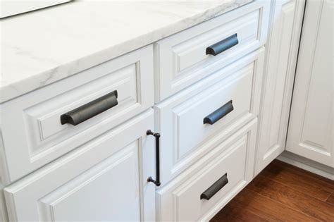 White Cabinets Bronze Hardware by White Raised Panel Cabinets With Rubbed Bronze Hardware