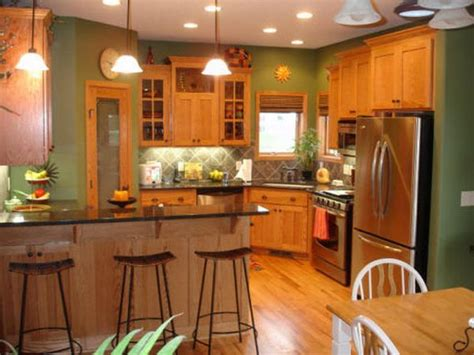 honey oak kitchen cabinets with black countertops and