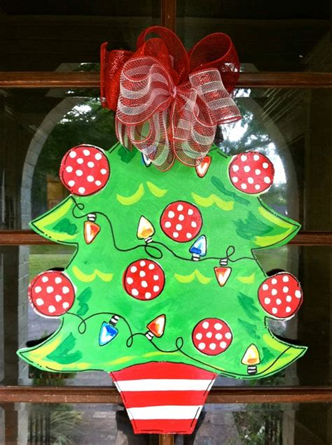 festive door decor traditional christmas wreathes