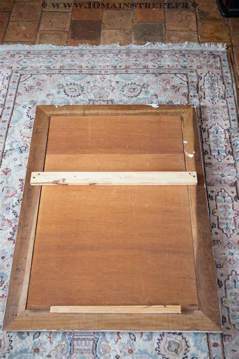 accrocher un cadre lourd comment accrocher un tableau lourd avec de la cimaise