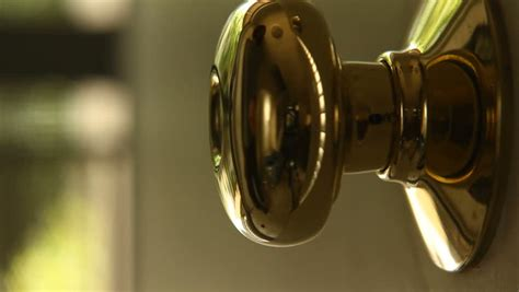 a golden door knob is locked with a key stock footage video 4927298 shutterstock