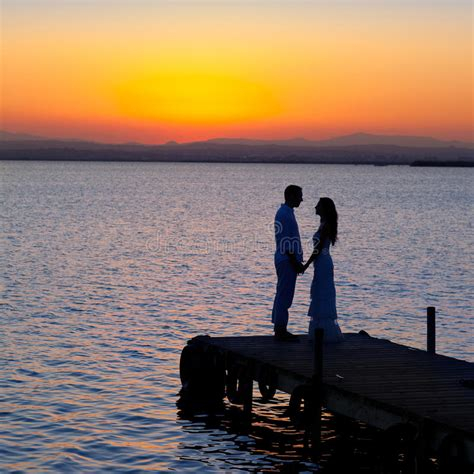 couple  love  light silhouette  lake royalty