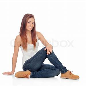 Casual young woman sitting on the floor isolated on a for How to sit comfortably on the floor