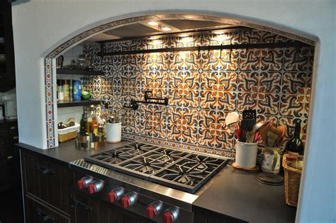 Beautiful Spanish Tile Backsplash with Stainless