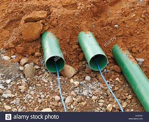 Road Construction Site Uk Trench With Green Ducts For