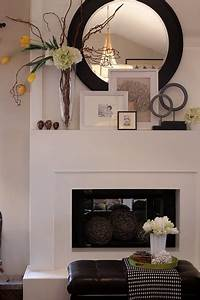 this simple fireplace and layering on the mantel